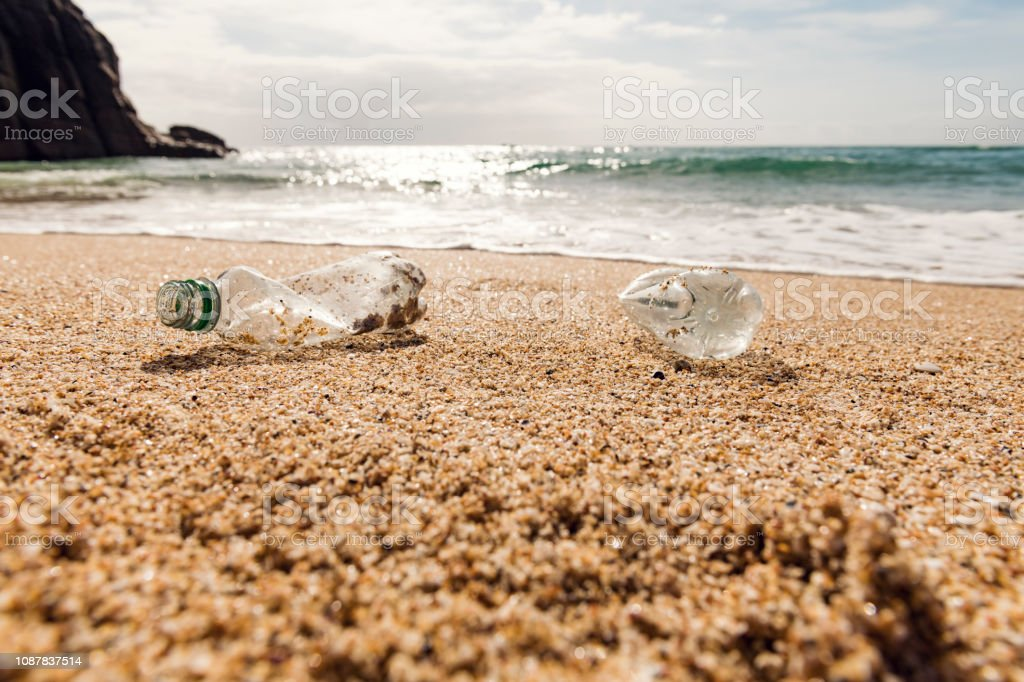 Washed up used Plastic Bottle on a beach. stock photo