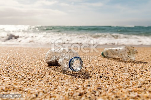Washed up used Plastic Bottle on a beach.