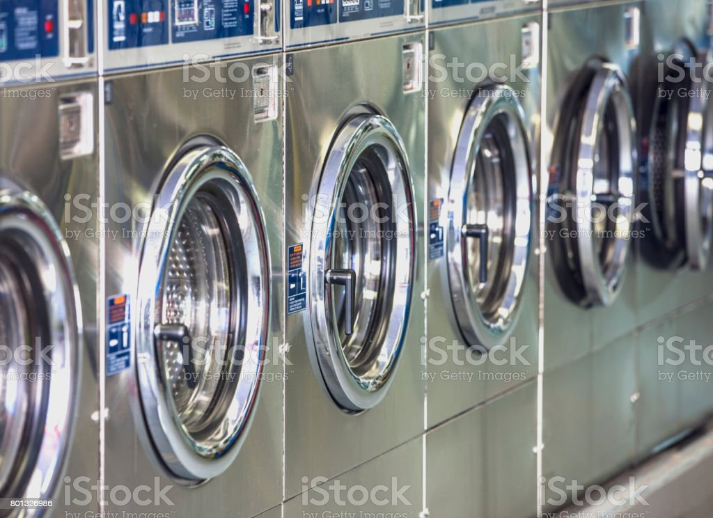 Washers and dryers in laundromat. stock photo