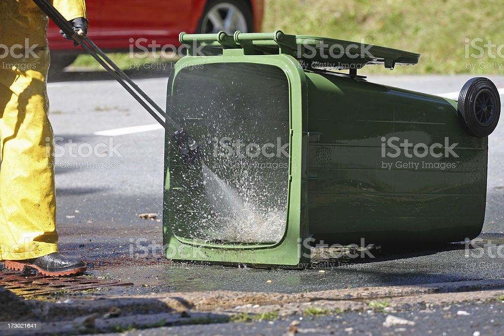 Washing A Green Bin Series stock photo