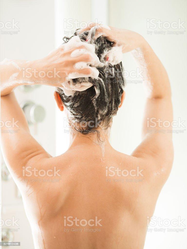 Washing a hair stock photo