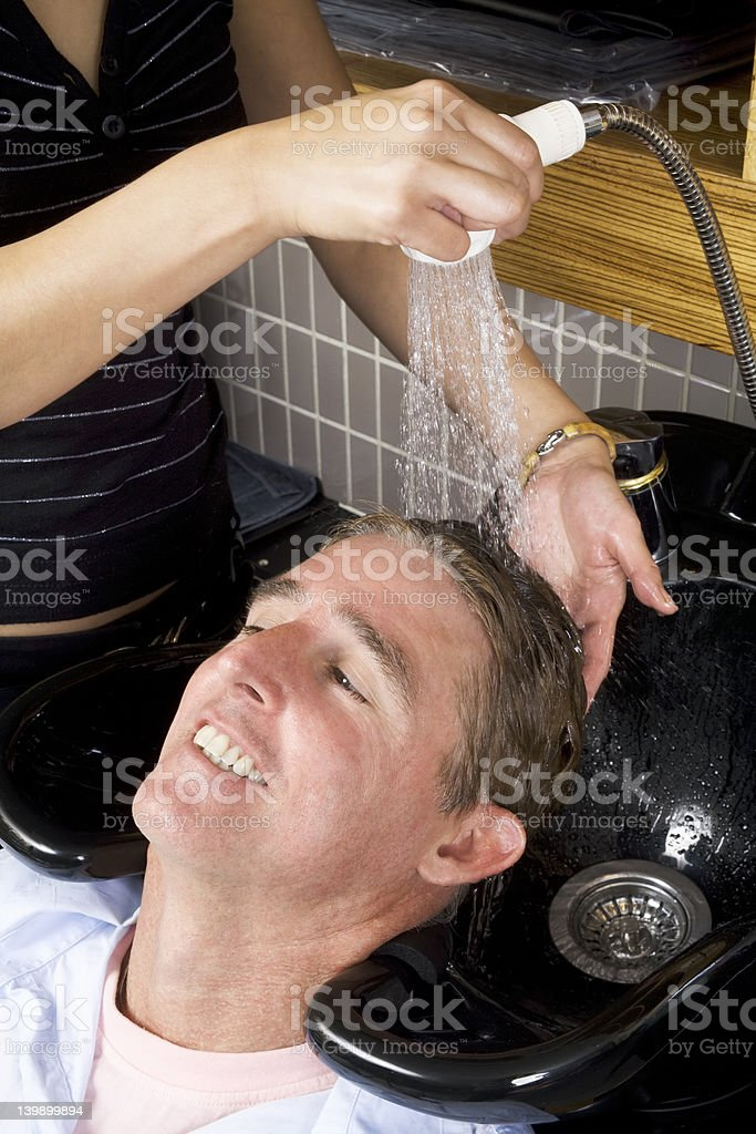 Washing a man's hair  close up royalty-free stock photo