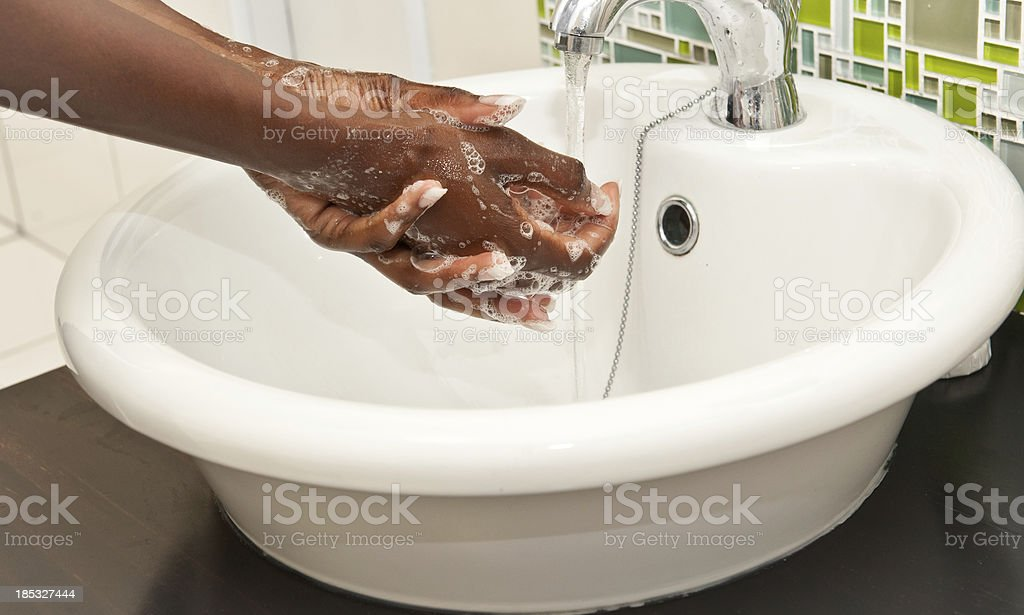 Washing African American Hands stock photo