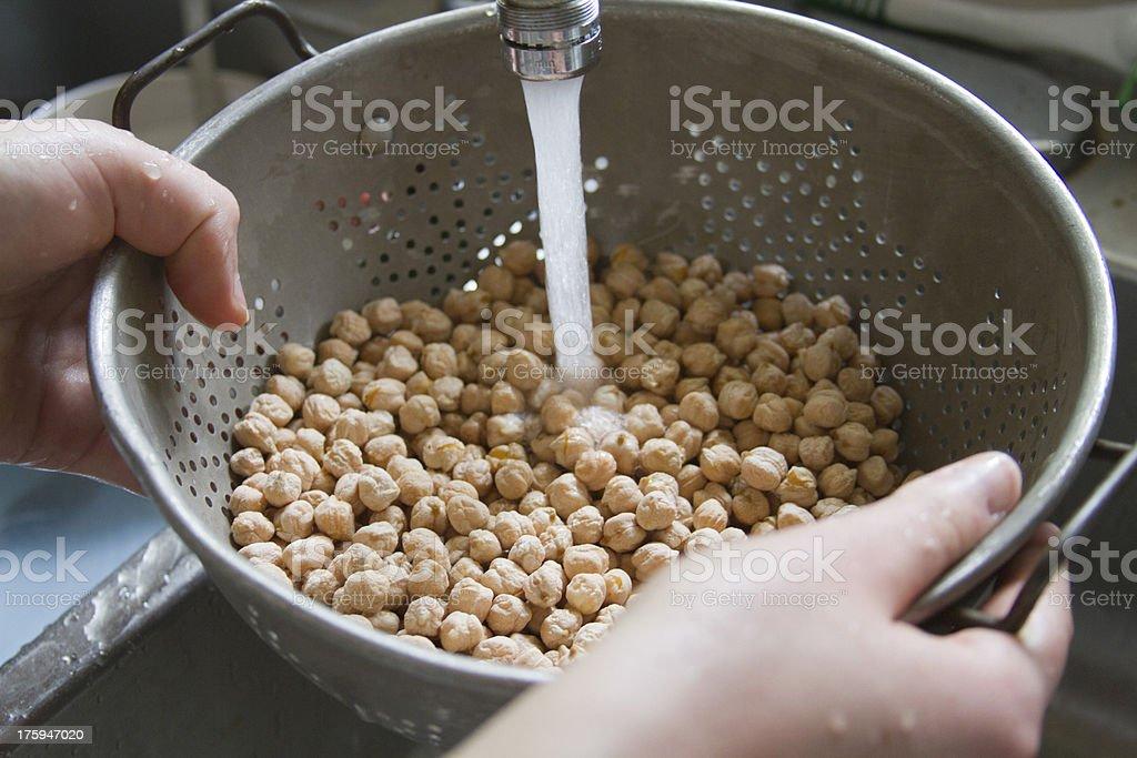 Washing Garbanzon Beans stock photo