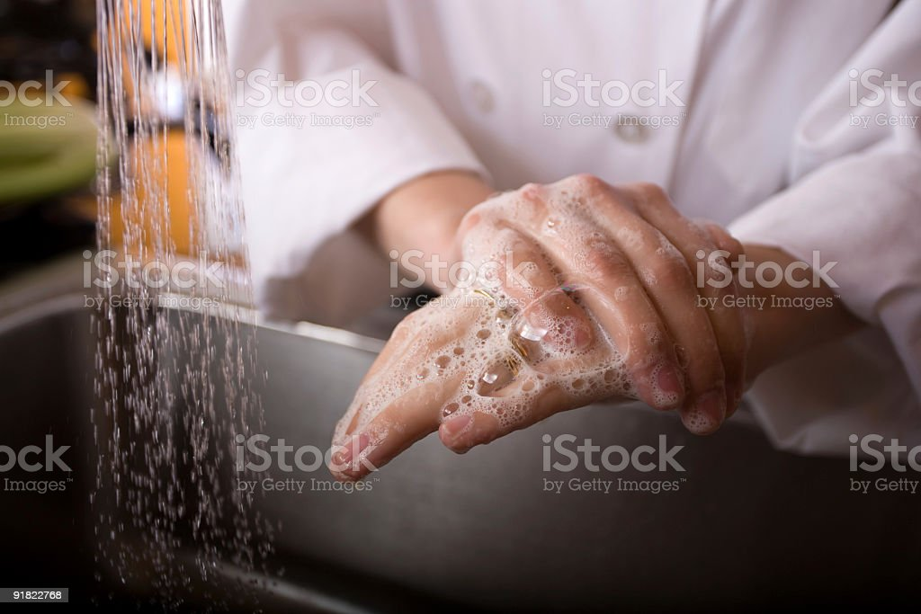 Washing hands in a sink stock photo