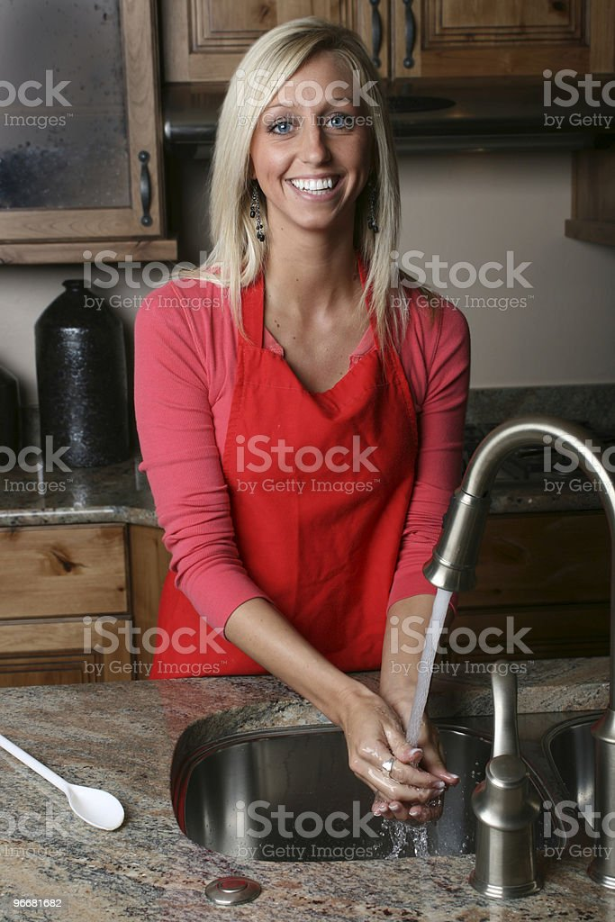 Washing Hands in the Kitchen royalty-free stock photo