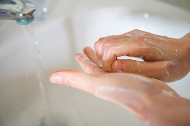 Washing hands rubbing with soap man for corona virus prevention stock photo