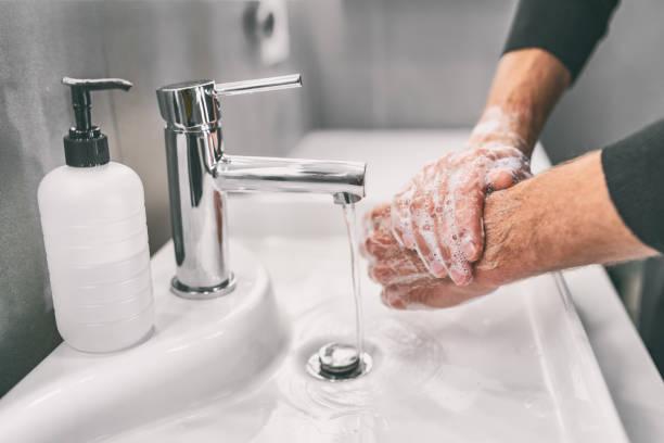 Washing hands rubbing with soap man for corona virus prevention, hygiene to stop spreading coronavirus stock photo