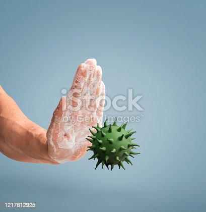 Human hand covered with soap sud , stopping a virus from spreading