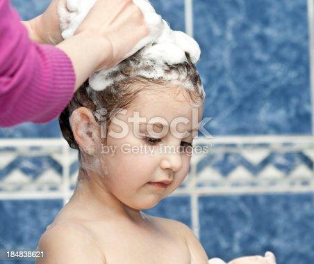 Baby girl in bath.