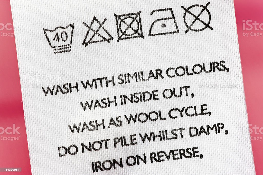 Washing instructions on clothes label stock photo