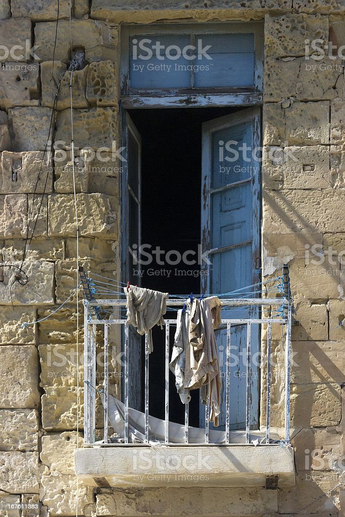Washing left out on rundown balcony royalty-free stock photo