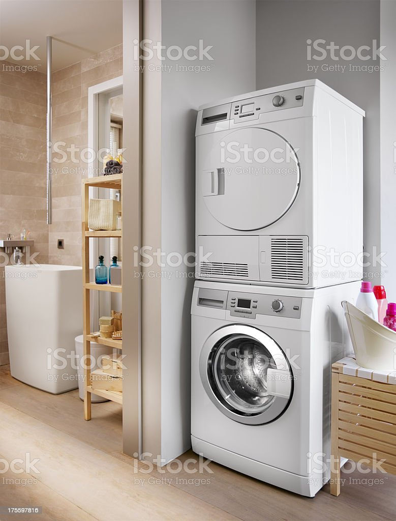 Washing machine and dryer in the bathroom stock photo