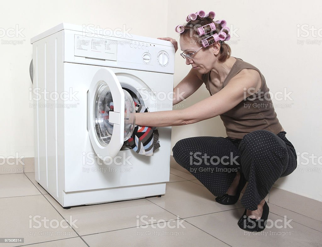 Washing machine and woman royalty-free stock photo