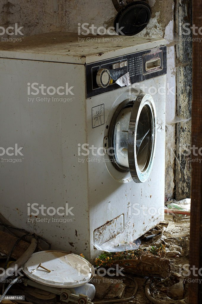 washing machine broken stock photo