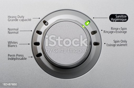 Close up of a modern silver washing machine control button with led. More in my laundry lightbox below...