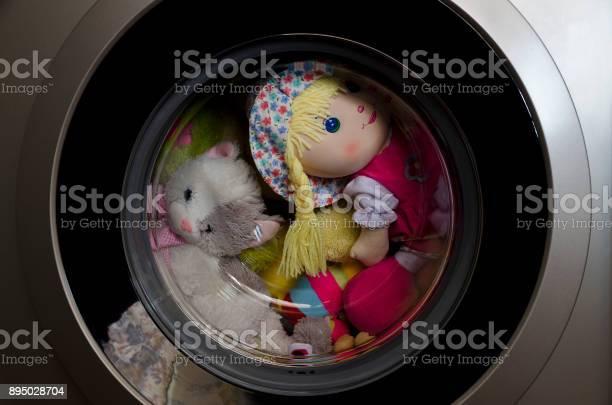 Washing machine door with rotating toys inside picture id895028704?b=1&k=6&m=895028704&s=612x612&h=dwmpoucgmlda3uvzlpph94axzltibz9diey2hzhvlae=