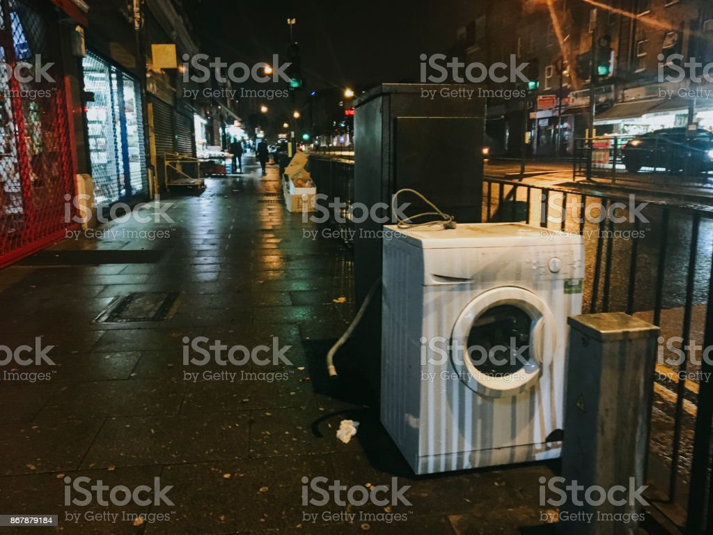 Washing Machine Dumped on the Street stock photo