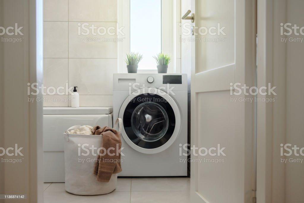 Washing machine in modern bathroom