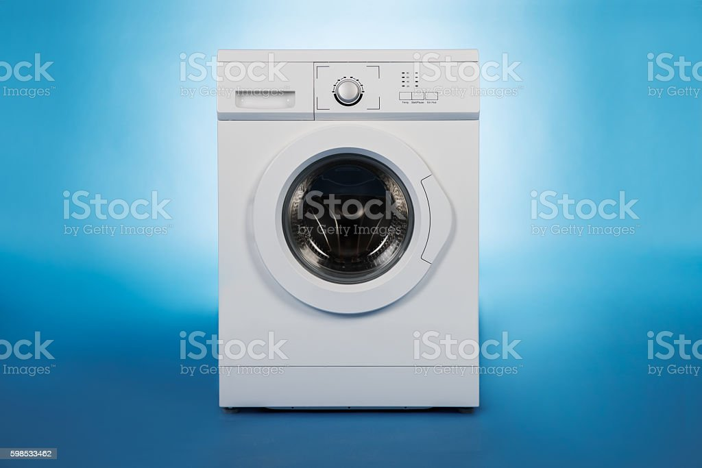 Washing Machine Over Blue Background photo libre de droits