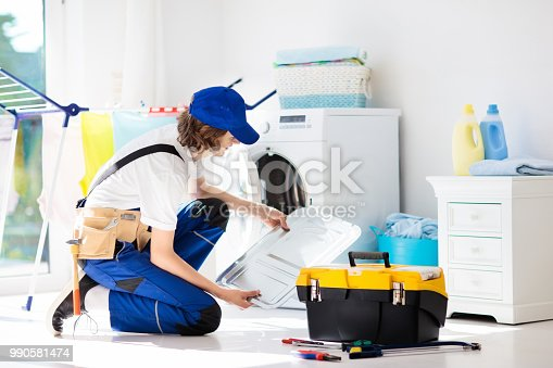 istock Washing machine repair technician. Washer service 990581474