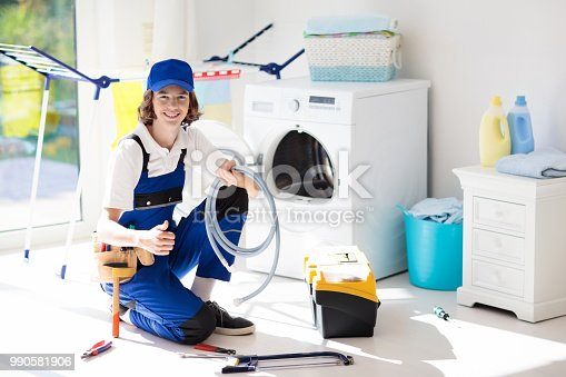 istock Washing machine repair technician. Washer service 990581906