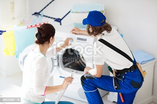 istock Washing machine repair technician. Washer service. 990588778