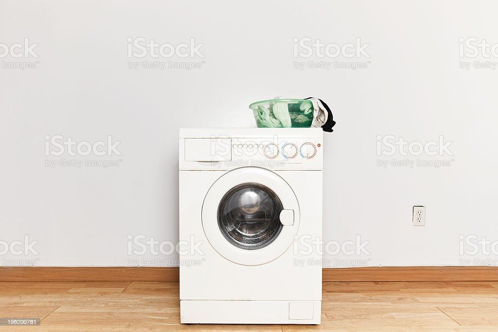 Washing machine with dirty laundry pile stock photo