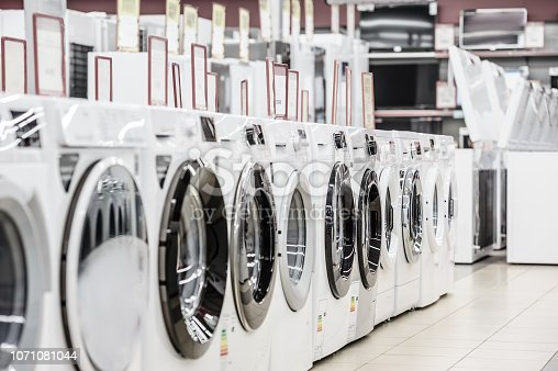 Row of washing mashines in appliance store