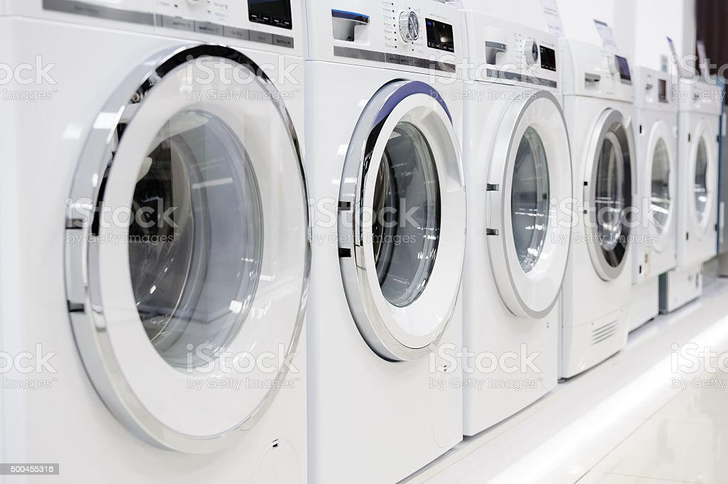 washing mashines in appliance store stock photo