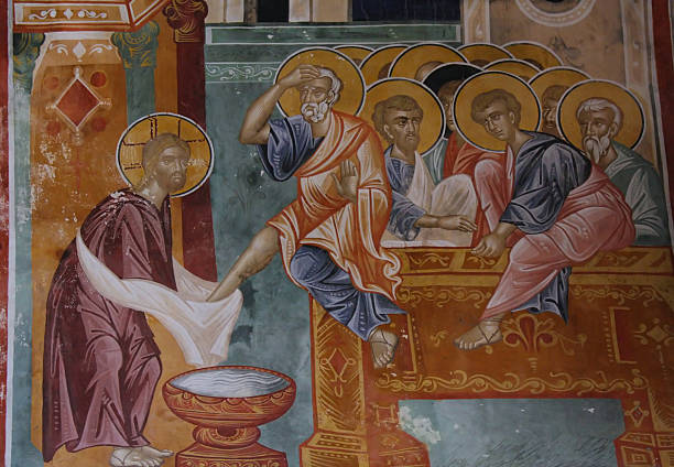 washing of feet - peter the apostle stock photos and pictures