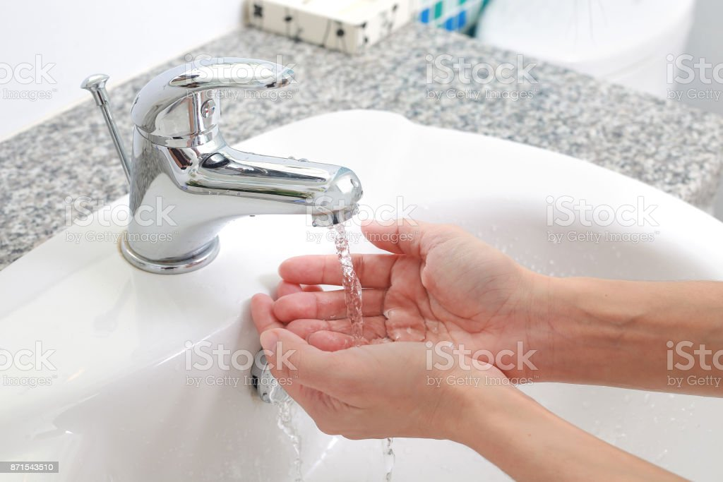 Washing of hands with under running water. stock photo
