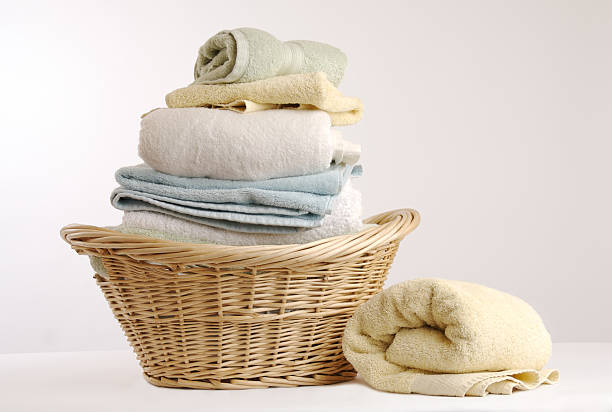 Washing...  laundry basket stock pictures, royalty-free photos & images