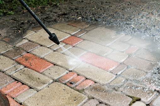washing services - block paving cleaning with high pressure washer