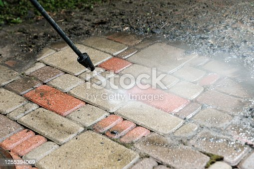 istock washing services - block paving cleaning with high pressure washer 1255394069