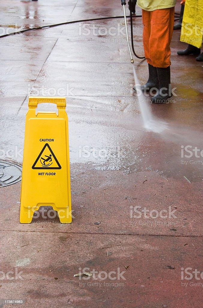 Washing the sidewalk royalty-free stock photo