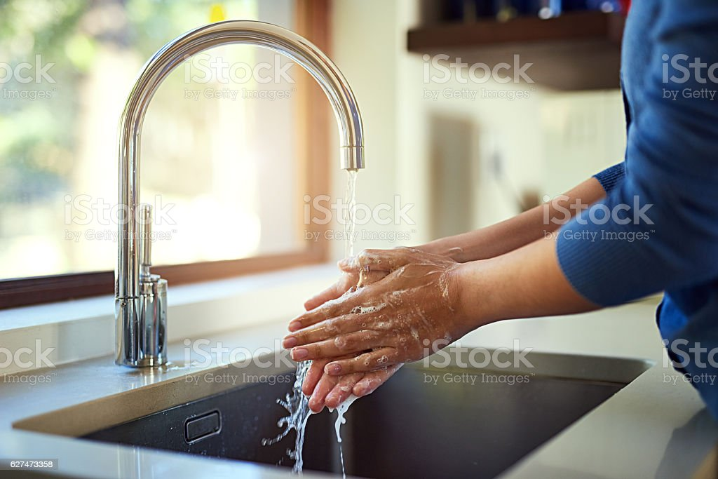 Washing up before dinner stock photo