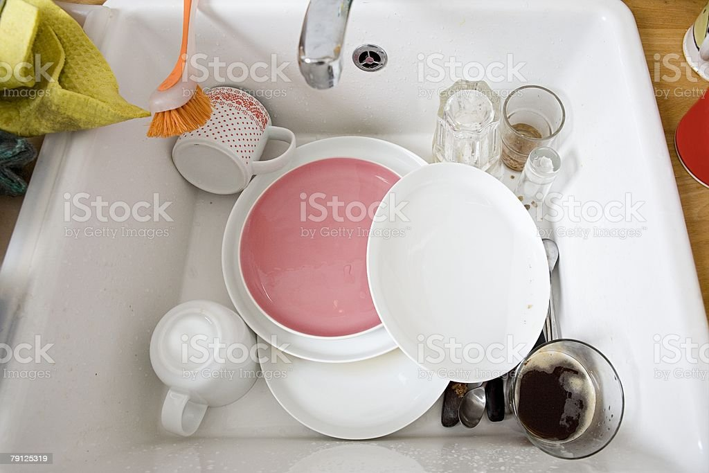 Washing up in sink 免版稅 stock photo