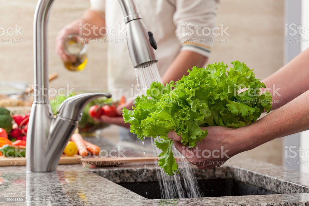 Washing vegetables for a salad stock photo