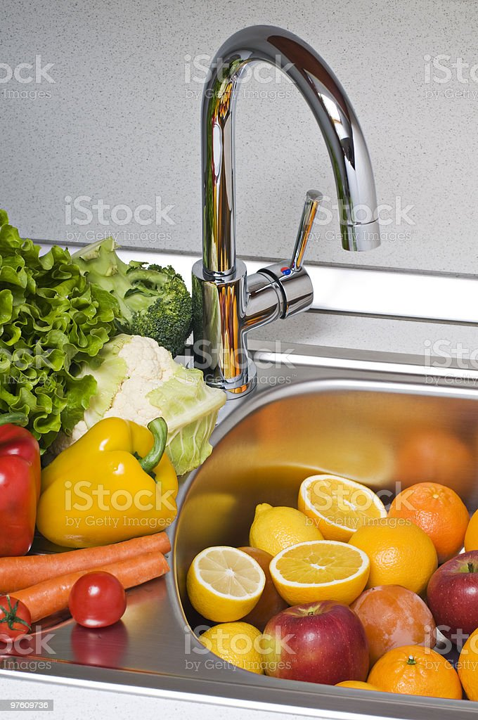 Washing vegetables royalty-free stock photo