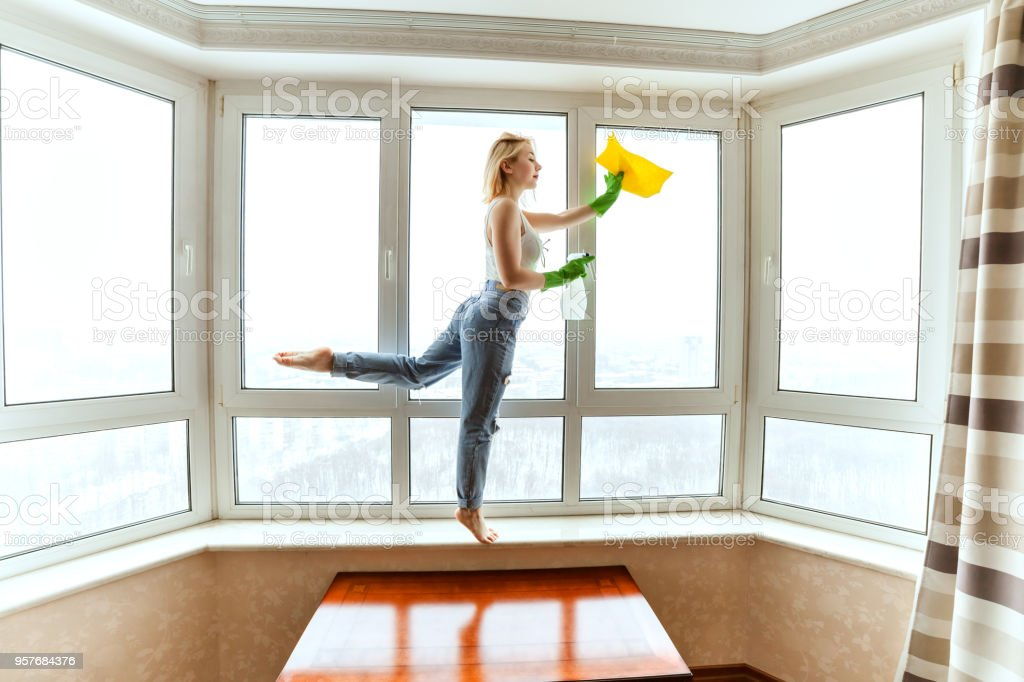 Washing windows during the dance. stock photo