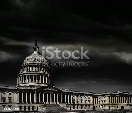 The United States capitol building with dark storm clouds above