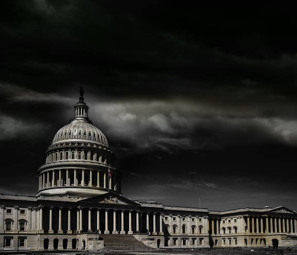 Washington DC capitol storm The United States capitol building with dark storm clouds above capitol hill stock pictures, royalty-free photos & images