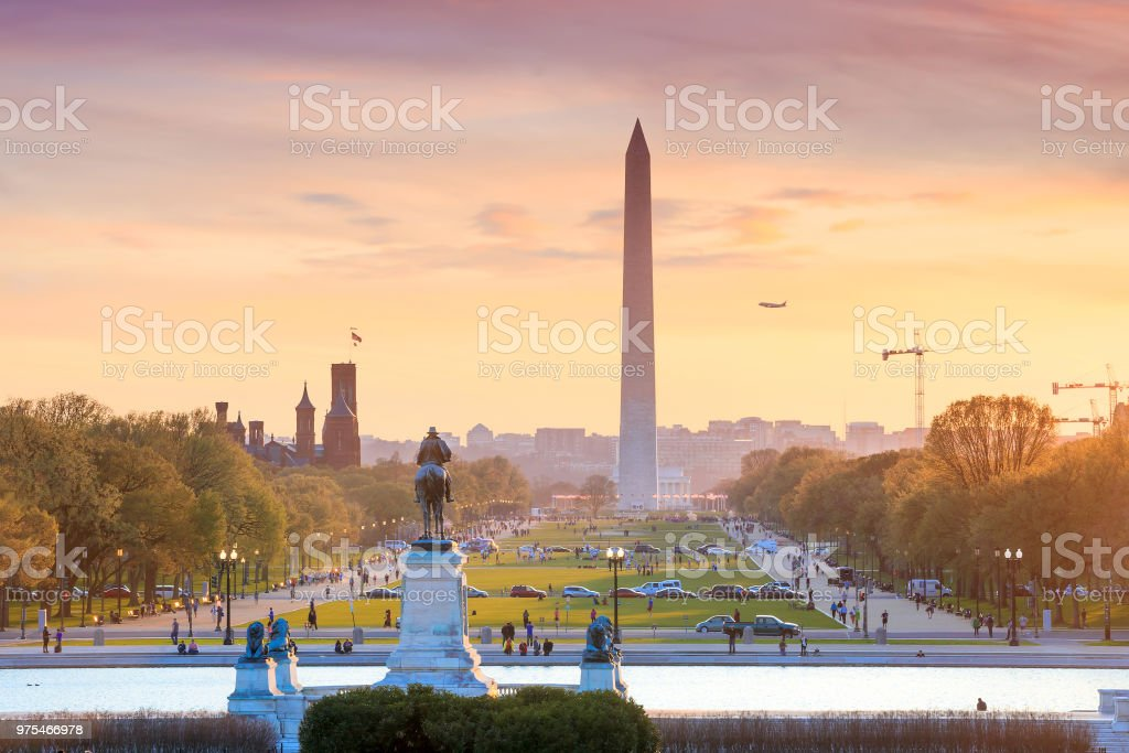 Washington DC city view at a orange sunset, including Washington Washington DC city view at a orange sunset, including Washington Monument from Capitol building Architectural Column Stock Photo