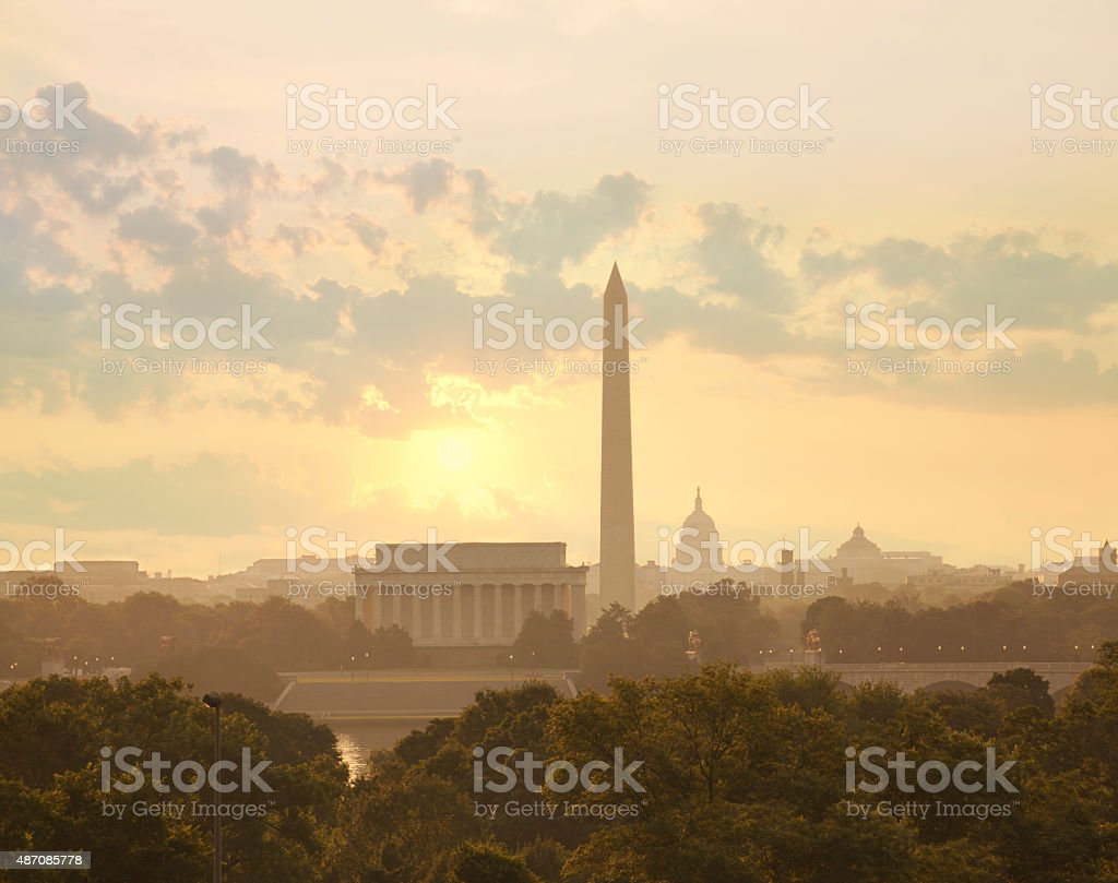 Washington DC skyline with sun and clouds in the morning stock photo