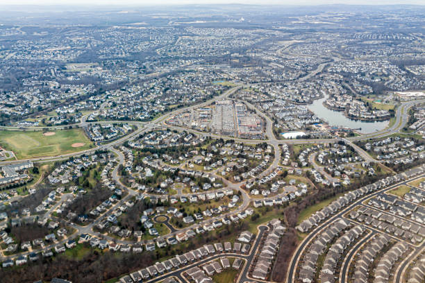 Washington DC suburbs in northern Virginia Dulles International Airport area with aerial view of buildings houses below in winter from airplane window stock photo