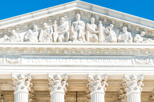 Washington DC, USA exterior of Supreme Court building marble architecture and closeup on Capital capitol hill columns pillars by entrance and sign stock photo