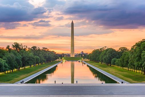 Washington Monument on the Reflecting Pool in Washington, D.C. at dawn.