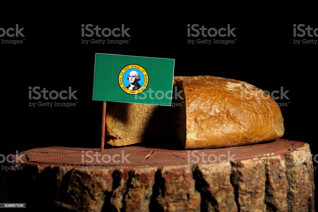 Washington flag on a stump with bread isolated stock photo