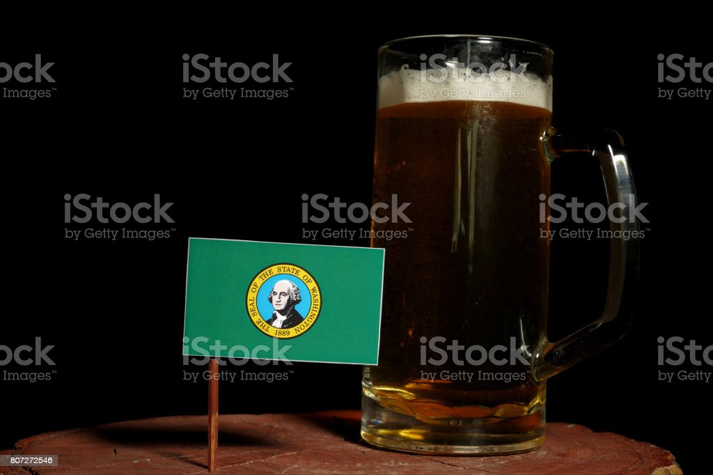 Washington flag with beer mug isolated on black background stock photo